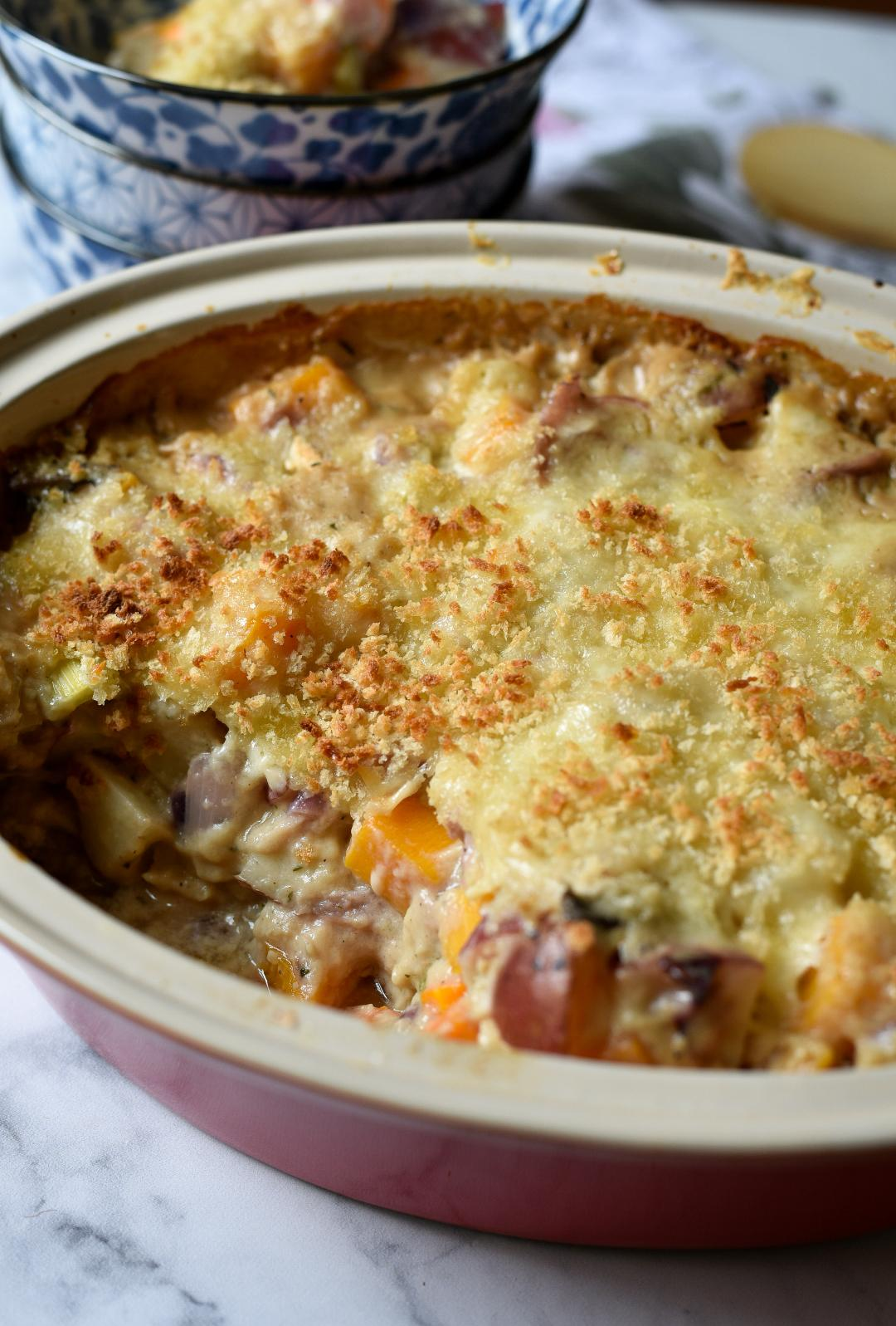 A casserole of vegetables topped with crispy cheese and panko
