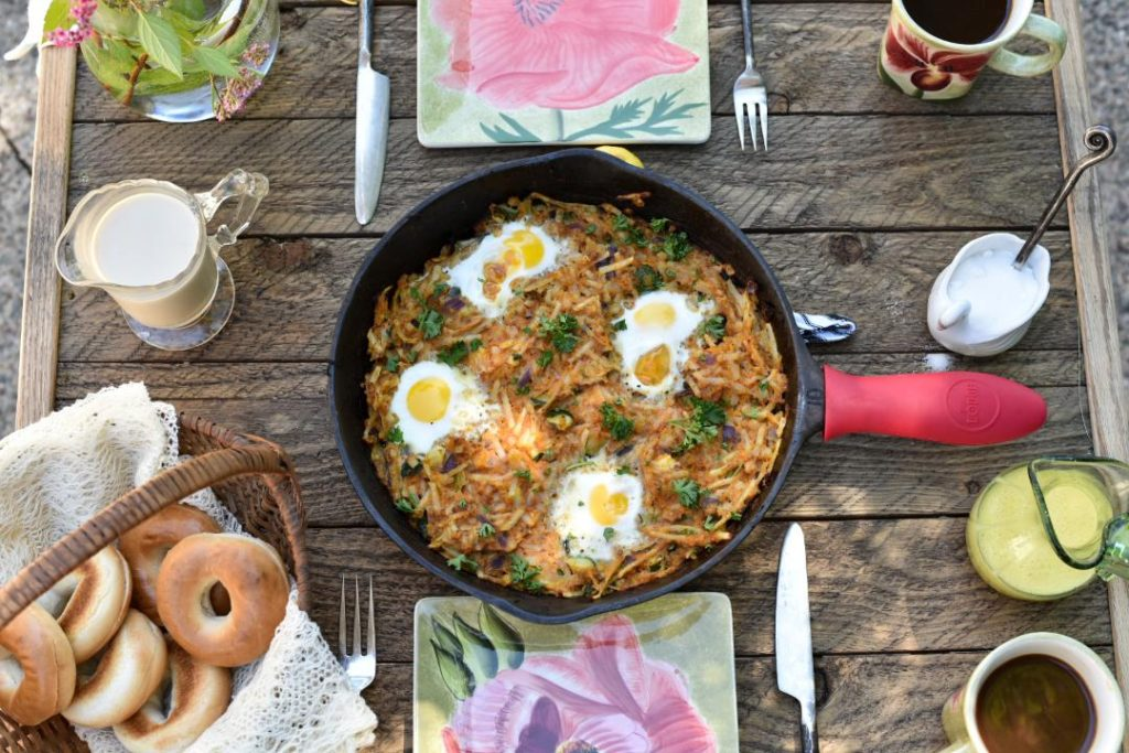 flat lay of corned beef hash in a cast iron skillet